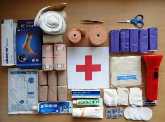 items of first aid kit on a table to build first aid kit