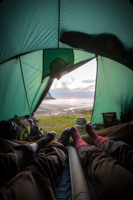 couple watching amazing view from tent